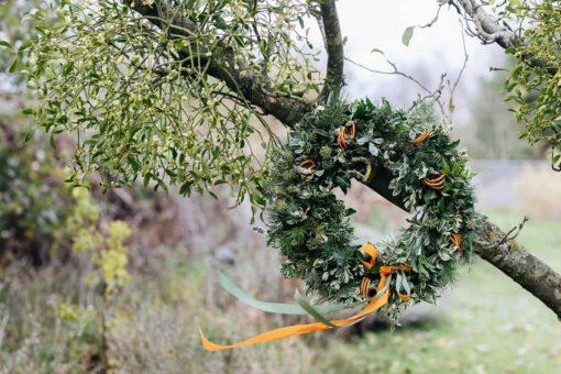 Fizzy Orange Christmas Wreath by Babylon Flowers florist Watlington